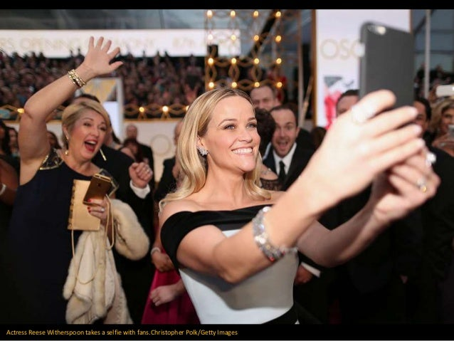 Actress Reese Witherspoon takes a selfie with fans.Christopher Polk/Getty Images