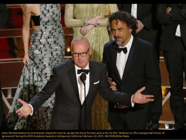 "Actor Michael Keaton (L) and director Alejandro Inarritu accept the Oscar for best picture for his film ""Birdman or (The U..."