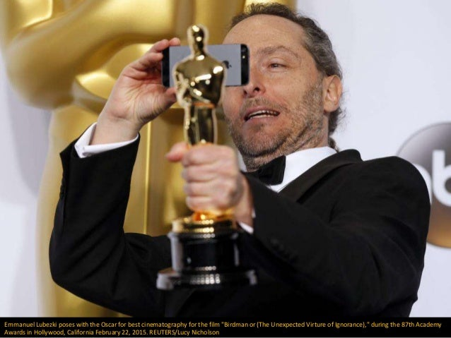 """Emmanuel Lubezki poses with the Oscar for best cinematography for the film """"Birdman or (The Unexpected Virture of Ignoranc..."""