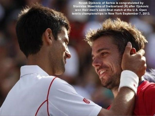 Novak Djokovic of Serbia is congratulated by Stanislas Wawrinka of Switzerland (R) after Djokovic won their men's semi-fin...