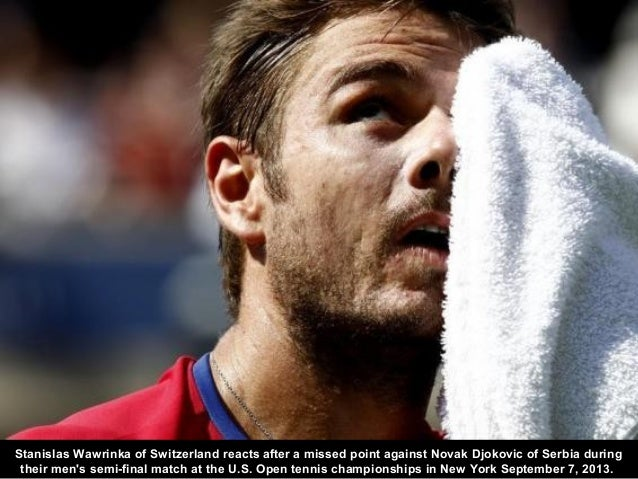 Stanislas Wawrinka of Switzerland reacts after a missed point against Novak Djokovic of Serbia during their men's semi-fin...