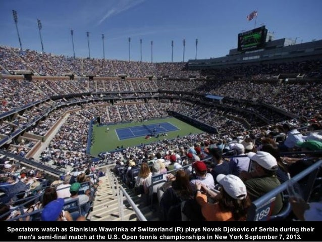 Spectators watch as Stanislas Wawrinka of Switzerland (R) plays Novak Djokovic of Serbia during their men's semi-final mat...