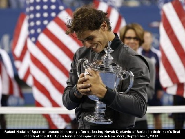 Rafael Nadal of Spain embraces his trophy after defeating Novak Djokovic of Serbia in their men's final match at the U.S. ...