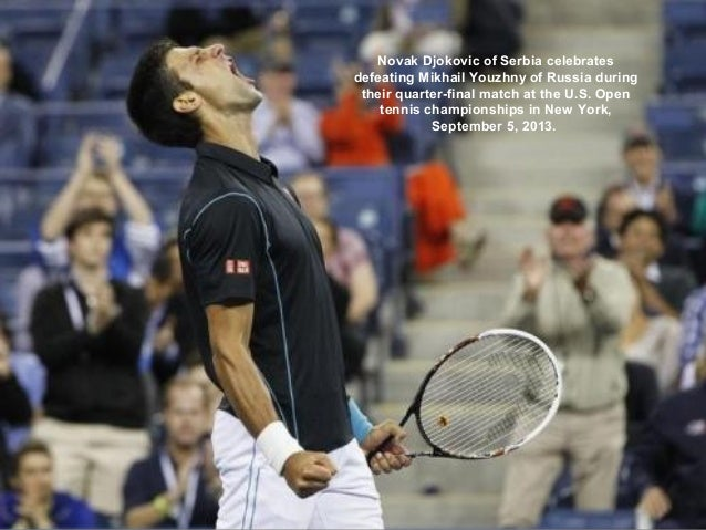 Novak Djokovic of Serbia celebrates defeating Mikhail Youzhny of Russia during their quarter-final match at the U.S. Open ...