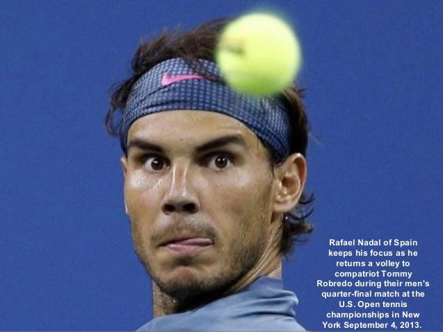 Rafael Nadal of Spain keeps his focus as he returns a volley to compatriot Tommy Robredo during their men's quarter-final ...