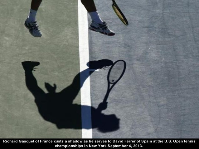 Richard Gasquet of France casts a shadow as he serves to David Ferrer of Spain at the U.S. Open tennis championships in Ne...