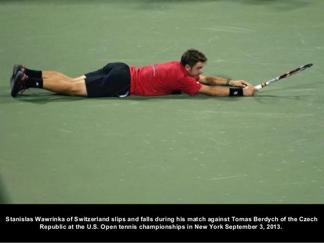 Stanislas Wawrinka of Switzerland slips and falls during his match against Tomas Berdych of the Czech Republic at the U.S....