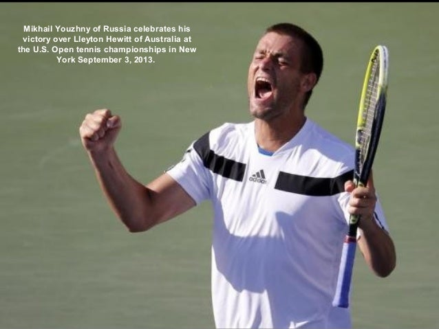 Mikhail Youzhny of Russia celebrates his victory over Lleyton Hewitt of Australia at the U.S. Open tennis championships in...