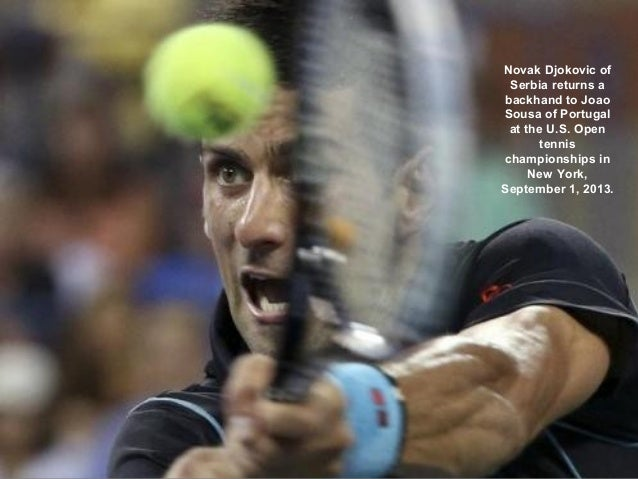 Novak Djokovic of Serbia returns a backhand to Joao Sousa of Portugal at the U.S. Open tennis championships in New York, S...