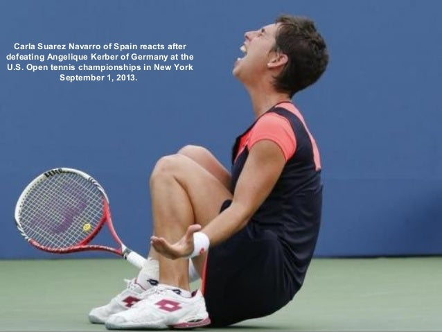 Carla Suarez Navarro of Spain reacts after defeating Angelique Kerber of Germany at the U.S. Open tennis championships in ...