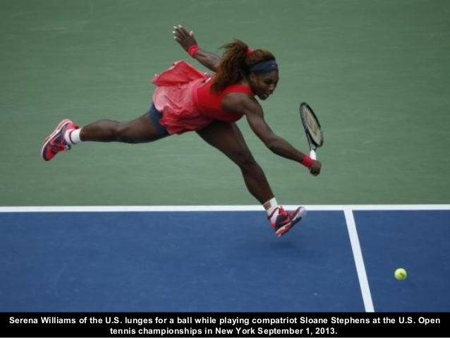 Serena Williams of the U.S. lunges for a ball while playing compatriot Sloane Stephens at the U.S. Open tennis championshi...