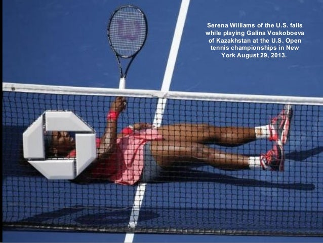 Serena Williams of the U.S. falls while playing Galina Voskoboeva of Kazakhstan at the U.S. Open tennis championships in N...