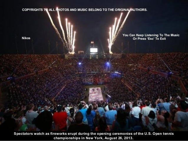 Spectators watch as fireworks erupt during the opening ceremonies of the U.S. Open tennis championships in New York, Augus...