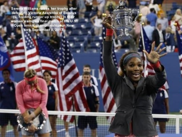 Serena Williams raises her trophy after defeating Victoria Azarenka of Belarus (L, holding runner up trophy) in their wome...