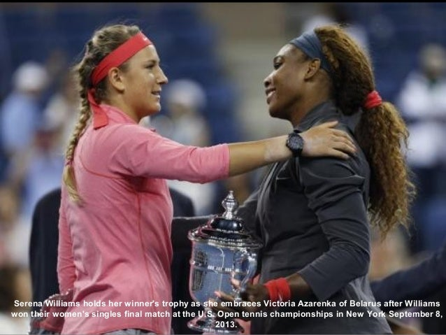 Serena Williams holds her winner's trophy as she embraces Victoria Azarenka of Belarus after Williams won their women's si...