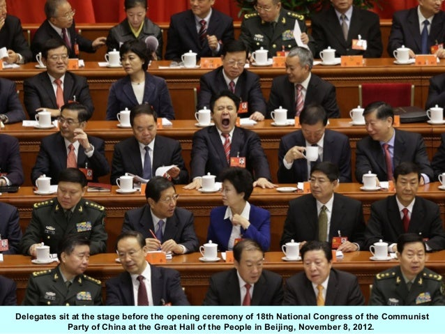 Delegates sit at the stage before the opening ceremony of 18th National Congress of the Communist            Party of Chin...