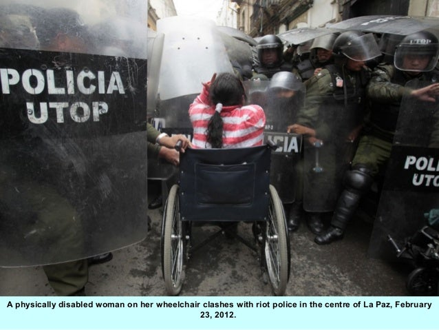 A physically disabled woman on her wheelchair clashes with riot police in the centre of La Paz, February                  ...