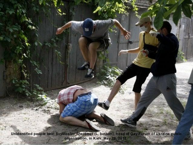 Unidentified people beat Svyatoslav Sheremet (L, bottom), head of Gay-Forum of Ukraine public                             ...