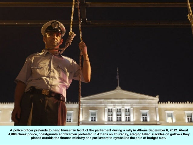 A police officer pretends to hang himself in front of the parliament during a rally in Athens September 6, 2012. About4,00...