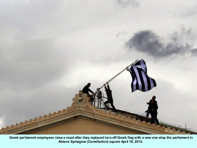 Greek parliament employees raise a mast after they replaced torn-off Greek flag with a new one atop the parliament in     ...