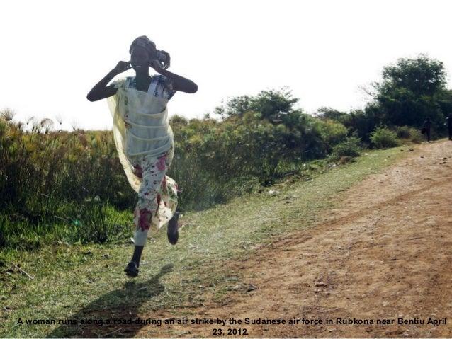 A woman runs along a road during an air strike by the Sudanese air force in Rubkona near Bentiu April                     ...