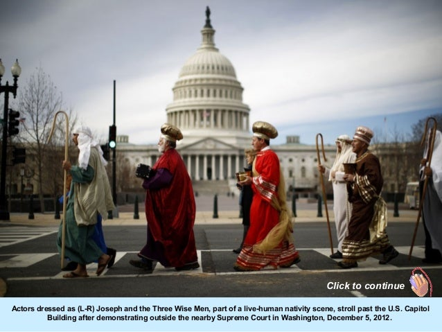 Click to continueActors dressed as (L-R) Joseph and the Three Wise Men, part of a live-human nativity scene, stroll past t...