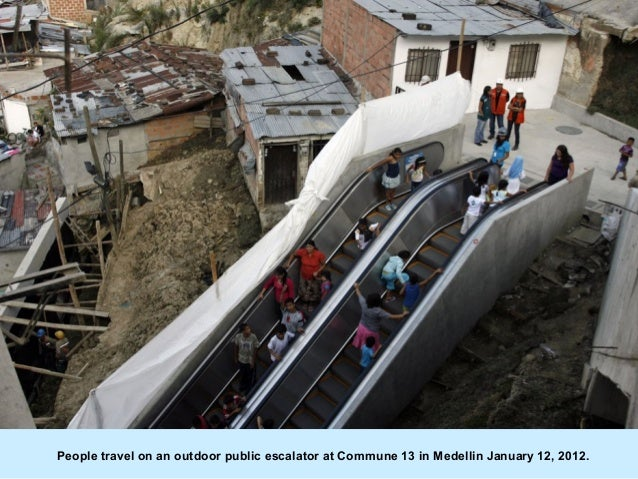 People travel on an outdoor public escalator at Commune 13 in Medellin January 12, 2012.