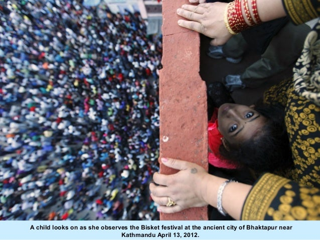 A child looks on as she observes the Bisket festival at the ancient city of Bhaktapur near                              Ka...