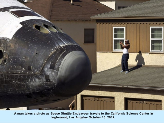 A man takes a photo as Space Shuttle Endeavour travels to the California Science Center in                       Inglewood...
