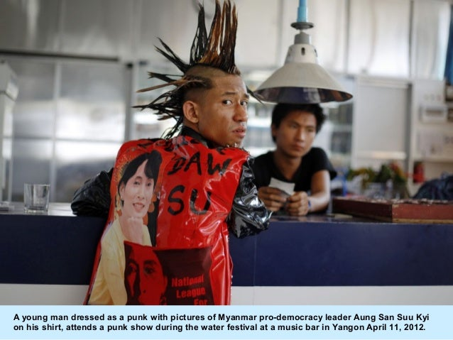 A young man dressed as a punk with pictures of Myanmar pro-democracy leader Aung San Suu Kyion his shirt, attends a punk s...