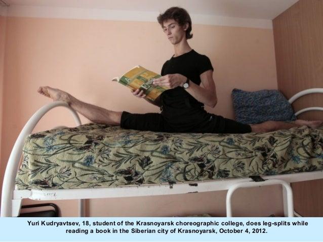 Yuri Kudryavtsev, 18, student of the Krasnoyarsk choreographic college, does leg-splits while            reading a book in...