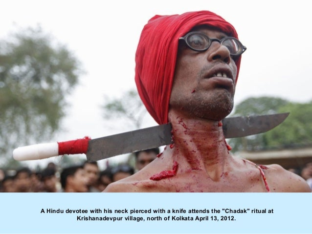 """A Hindu devotee with his neck pierced with a knife attends the """"Chadak"""" ritual at           Krishanadevpur village, north ..."""