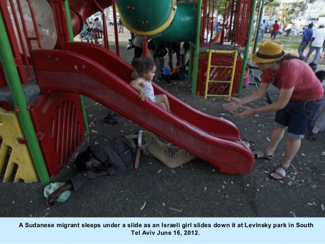 A Sudanese migrant sleeps under a slide as an Israeli girl slides down it at Levinsky park in South                       ...