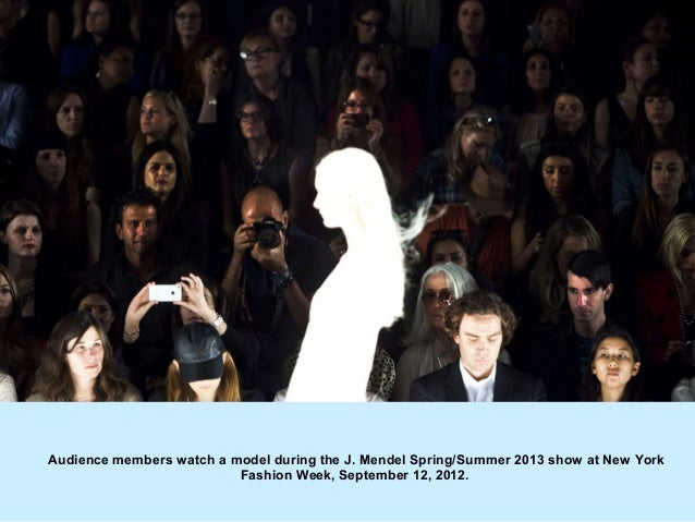 Audience members watch a model during the J. Mendel Spring/Summer 2013 show at New York                          Fashion W...