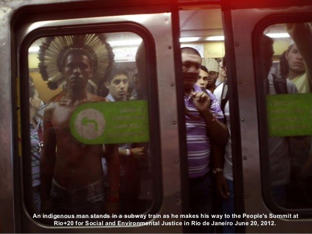 An indigenous man stands in a subway train as he makes his way to the Peoples Summit at       Rio+20 for Social and Enviro...
