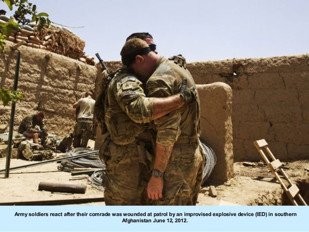 Army soldiers react after their comrade was wounded at patrol by an improvised explosive device (IED) in southern         ...