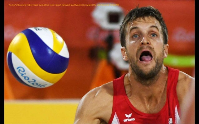 Netherlands' Robin De Kruijf (L) and Netherlands' Lonneke Sloetjes react following the women's qualifying volleyball match...