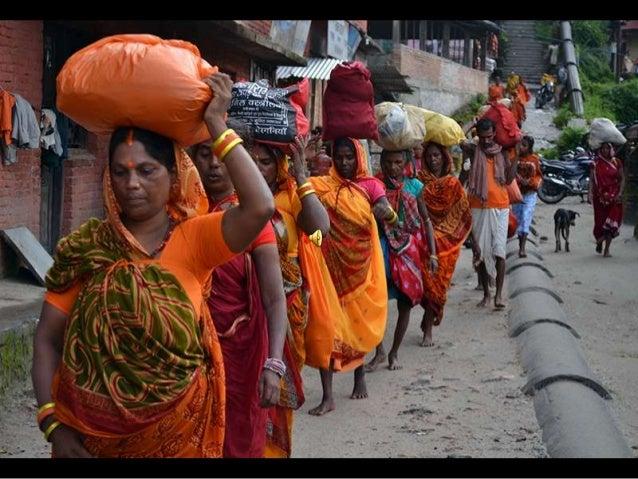 "A Hindu devotee takes a dip at the Bagmati River as she participates in the ""Bol Bom"" (Say Shiva) pilgrimage in Kathmandu ..."