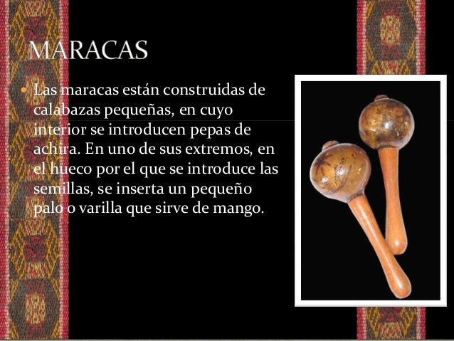  El guasá esta hecho de un canuto de caña guadúa, cerrado por un lado por el nudo de la caña por el otro lado tapado con ...