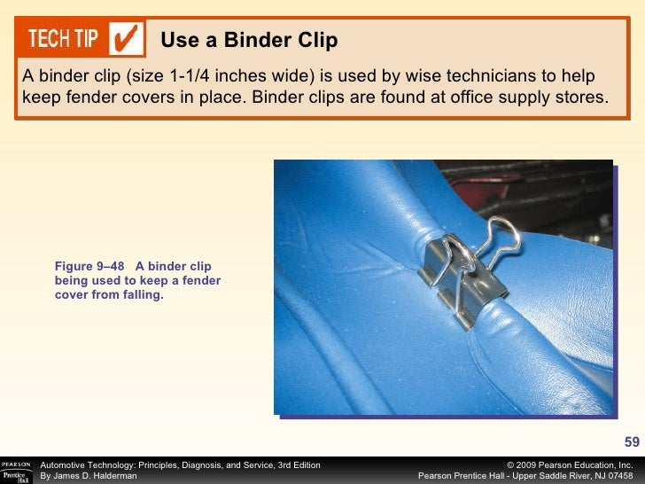 Figure 9–48 A binder clip being used to keep a fender cover from falling. A binder clip (size 1-1/4 inches wide) is used b...