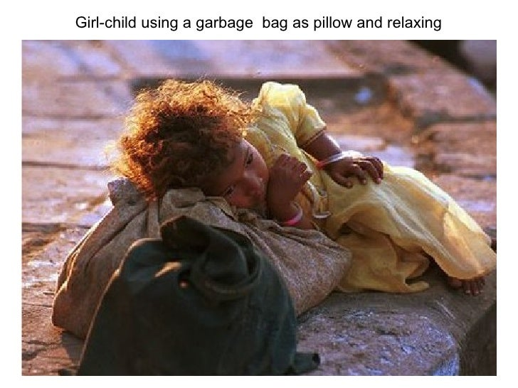 Girl-child using a garbage  bag as pillow and relaxing