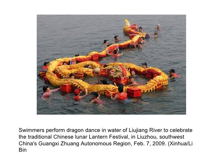 Swimmers perform dragon dance in water of Liujiang River to celebrate the traditional Chinese lunar Lantern Festival, in L...