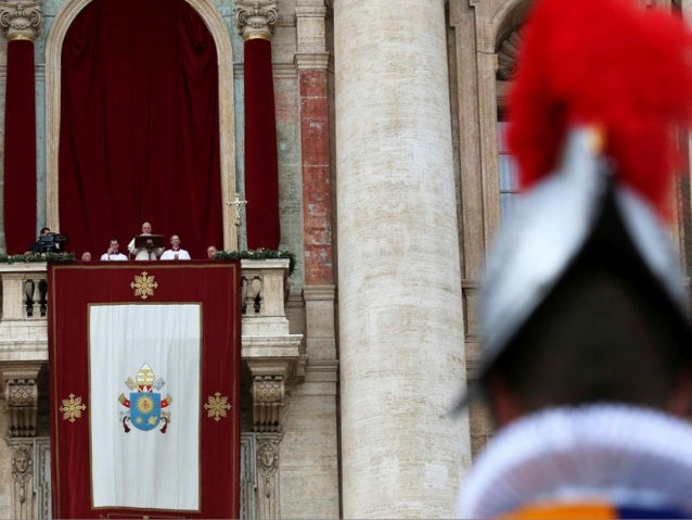 Pope Francis greets the faithful after delivering the Urbi et Orbi Christmas Day message from the central balcony of St Pe...