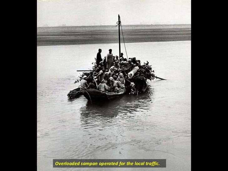 Overloaded sampan operated for the local traffic.