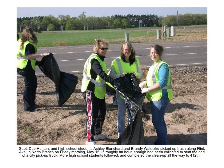 Supt. Deb Henton, and high school students Ashley Blanchard and Brandy Waletzko picked up trash along Flink Ave. in North ...