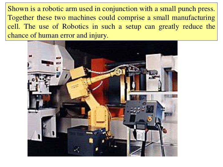 Shown is a robotic arm used in conjunction with a small punch press.Together these two machines could comprise a small man...