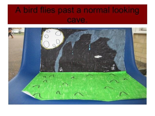 A bird flies past a normal lookingcave.