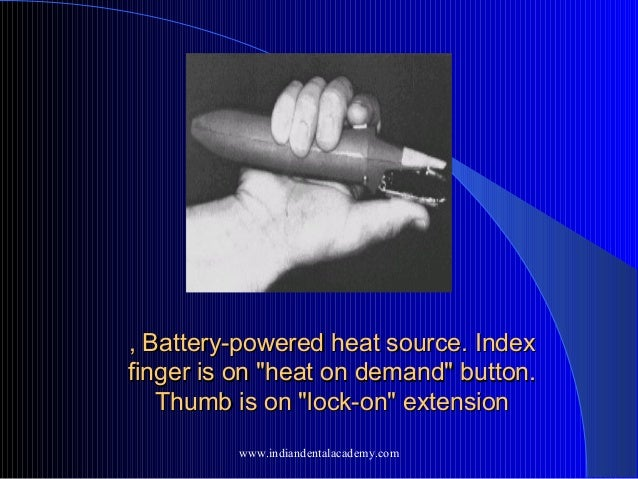 """, Battery-powered heat source. Index finger is on """"heat on demand"""" button. Thumb is on """"lock-on"""" extension www.indiandenta..."""