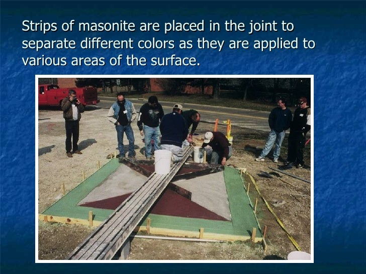 Strips of masonite are placed in the joint to separate different colors as they are applied to various areas of the surface.