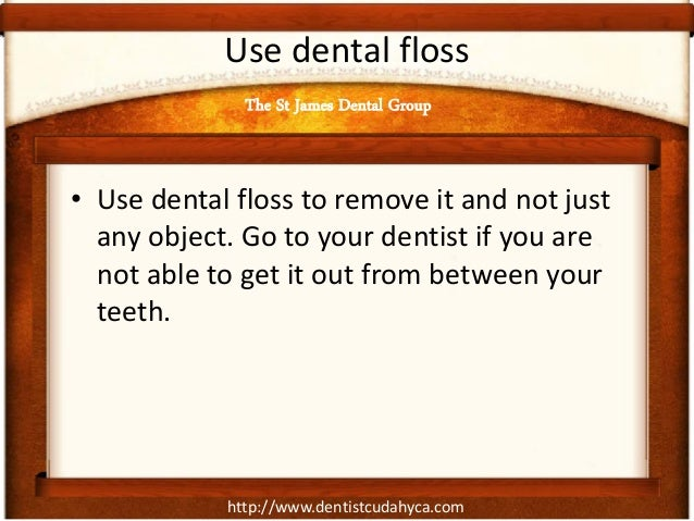 http://www.dentistcudahyca.com Use dental floss • Use dental floss to remove it and not just any object. Go to your dentis...